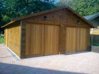 20x26 garage with felt tiles and a personal door. Special doors with motorised openings included.
