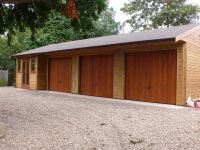3 Car Garage and a Workshop with Contemporary Office D/G Doors and Windows.