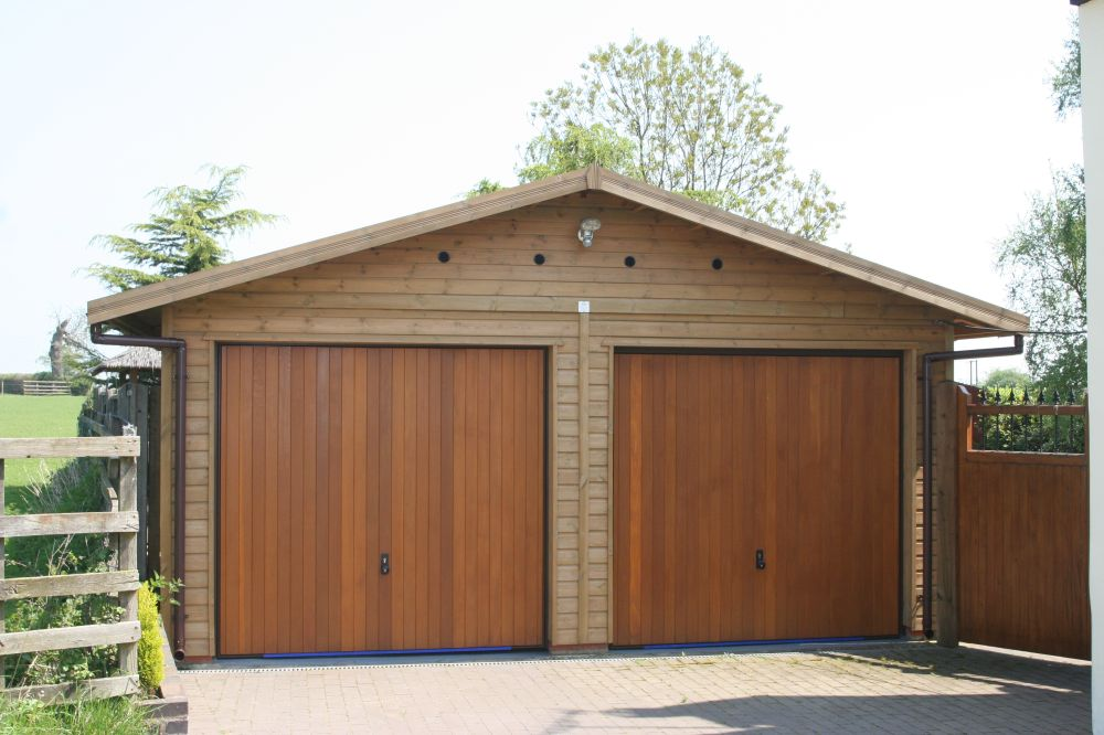 nice double garages #1: Double Garage with Cedar Up u0026 Over doors in the Gable End