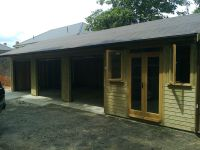 3 bay garage with an office at the end. Felt tile roof and garden office doors and windows.