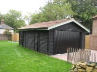 Feather Edge Garage with Cedar Shingles. Painted ebony wood protector.