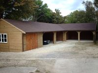 L-Shaped Garage in Shiplap with Felt Tile Roof, and Cart Lodge Fronts.