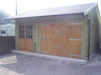 Garage with a lined canopy to the front of the building.