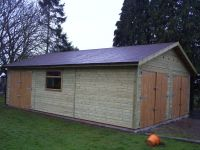 20 x 30 with doors in the gable end, and an extra set to the side. With felt tile roof.