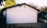 Double Garage with a 14ft Up & Over door. Customer painted white with black barge boards.