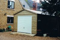 Single Garage without overhangs. Including a white U&O door, and brown felt tiles.