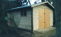 Standard garage with standard doors, personal door, garage window and green felt. Size is 10 wide x 16 deep.