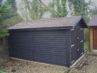 10 x 16 Feather edge garage with cedar shingles.
