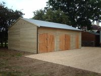 30 x 20 Garage with extra height for car lift. Customer already had existing garage (in the background)