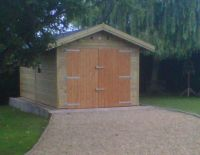 10 x 20 Garage with standard doors and a felt tile roof.
