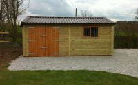 20 x 10 Garage with a brown metal roof, with standard double doors and a garage window.