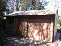 Single garage with a workshop. Finished with cedar shingles and a cedar Up & Over door.