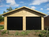 20 x 20 Garage with Black Up & Over Doors in the gable end.