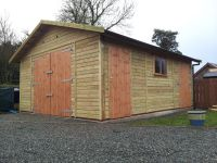 Large single garage that is 4.9m wide x 6.1m deep, with standard double doors, plus 2 x personal doors and a standard window
