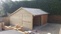 Feather edge garage with offset ridge and a tapco slate roof