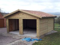 Double garage with Cedar shingles - ready for customers own door