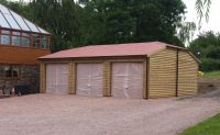 Triple Garage with a half hip roof with Tapco Slate