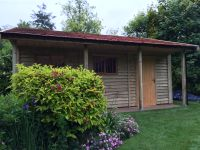 Side view of a feather edge garage with cedar shingles
