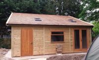 Large Garage with a cedar shingle roof