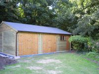 40 x 20 Double Garage & Workhop with a Cedar Shingle Roof, Standard Doors and Window.