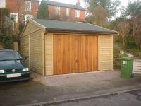 13 x 18 Single Garage with a Felt Tile Roof. Doors are under the guttering (not in Gable End)