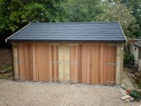 Double Garage with Cedar Double Doors and Recycled Tiles