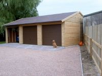 Triple garage with brown metal Up & Over doors & Felt Tiles. (Dog not available)
