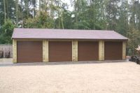 Quadruple garage with 4 brown Up & Over doors