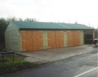 40 x 20 garage with 3 sets of standard double doors. 10 x 20 area utilised as stable area.