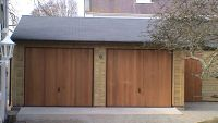 20 x 20 Garage with Cedar U&O Doors and a grey felt tile roof.