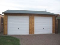 20 x 18 Garage with 2 White Metal U&O doors and a green felt roof.