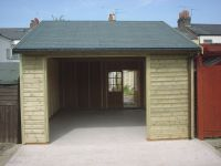 14 x 20 Garage with an opening for customers own door and a set of 6 pane doors in the back. Slate Grey Felt Tiles.