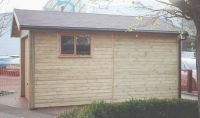 10 x 16 Garage with a Cedar U&O door, garage window and Felt Tiles