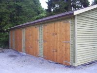 36 x 20 Garage with standard double doors and a felt tile roof.