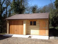 20 x 20 Garage with a Cedar Door, Personal Door and a Garage Window with Grille. The front of the workshop area has a lined canopy porch.