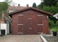 12 x 20 Garage with a set of Herringbone Double Doors. Customer has treated the building after assembly. This building was 7 years old when the picture was taken.