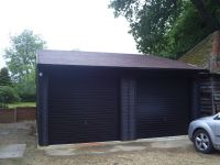 Double Garage with Up & Over Doors - Painted black by customer.