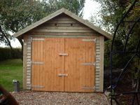 10 x 18 Feather Edge Garage with a higher pitched roof.