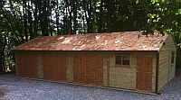 Lovely garage with a cedar shingle roof, and standard double doors