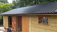 12m x 6m with Double Garage, Log Store and Work Room featuring a metal profile roof