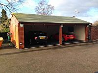 Double garage with motorised up & over doors in white metal