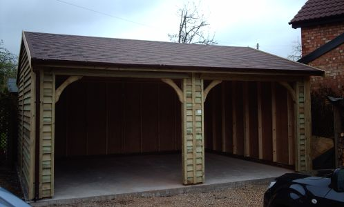 Cart Lodge Style Garage with a feather edge finish and a Red/Brown Felt Tile Roof. Special trusseS can be also be fitted to carry Clay or Slate Tiles. This design is becoming a popular alternative to the traditional oak framed buildings and can be used for log stores, as well as open fronted garages
