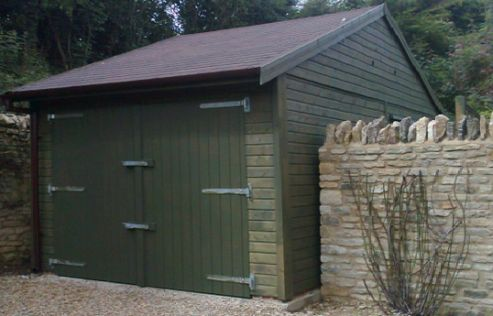 A roomy Single Garage which fits neatly into this Cotswolds setting. The Protek Spruce Green Double Doors, Galvanised Fittings and Red/Brown Roof are in keeping with the natural heritage feel that this customer was looking to create